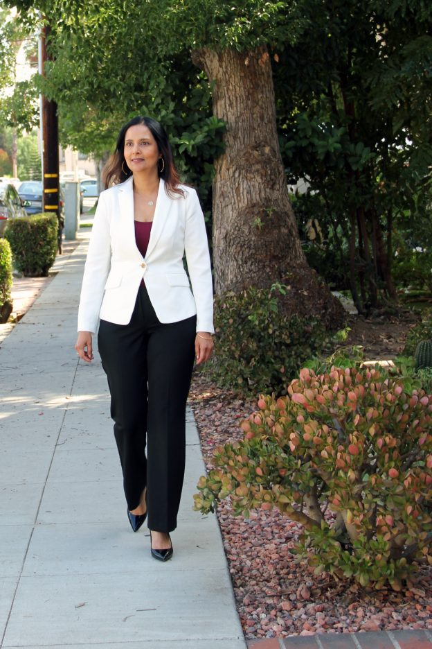 Dr. Reina Haque walking outside in Pasadena