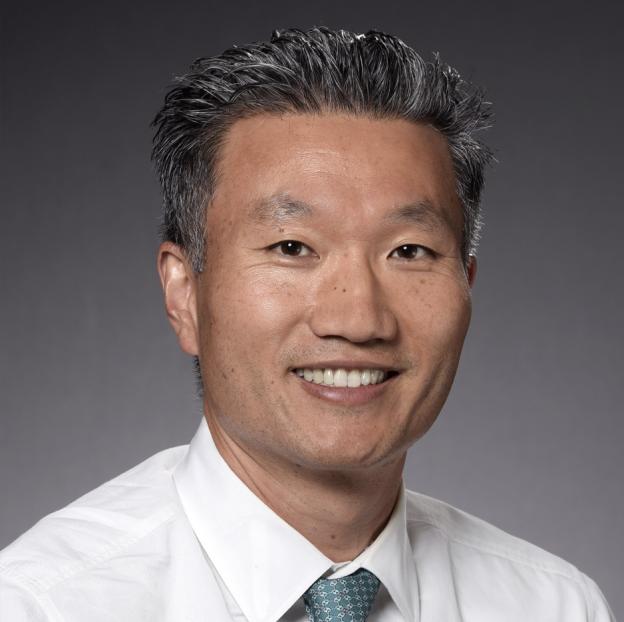 Dr. John Sim headshot