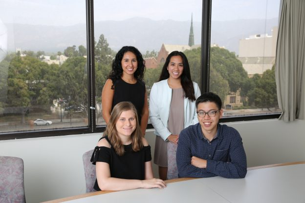 Summer interns in conference room at Department of Research & Evaluation headquarters in Pasadena, California.
